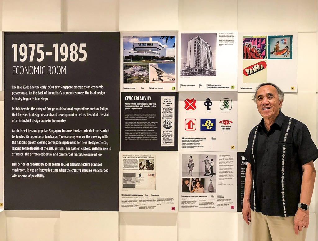 Wei posing beside his logo design in the Design Hall of Fame in Singapore.